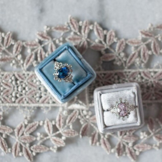 claire-pettibone-ring-collection-two-rings-in-boxes-on-lace-0915_sq